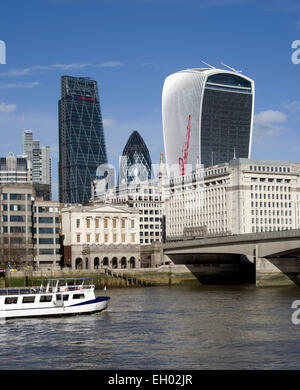 New and old buildings in the old city district of London including The Monument dwarfed by The Walkie Talkie - Stock Image