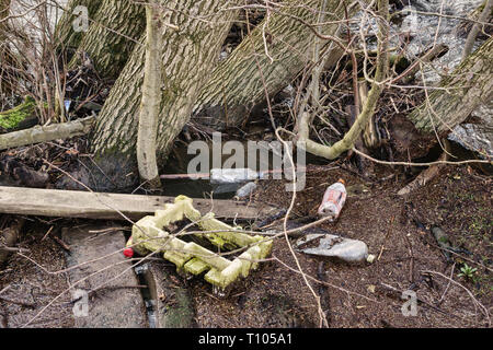 UK. Plastic waste floating in the River Lugg, in a remote rural area in mid-Wales - Stock Image