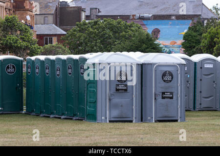 A row of portaloo's at an outdoor event or festival - Stock Image
