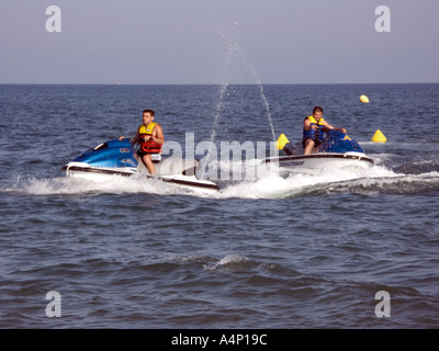 Jetskis in the Mediterranean La Cala de Mijas Mijas Costa Malaga Spain - Stock Image