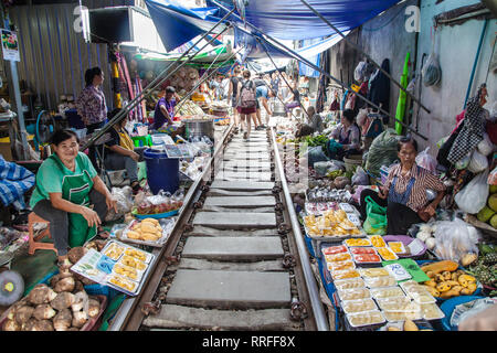 Maeklong, Thailand - August 29, 2018: The Railway Market in Maeklong, Thailand, also known as the Umbrella Pull Down Market. - Stock Image