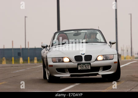 A Gray BMW M Roadster Convertible in an autocross race at a regional Sports Car Club of America (SCCA) event - Stock Image