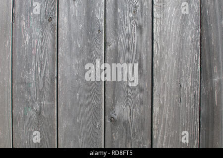 Weathered wide grey cedar fence boards. - Stock Image