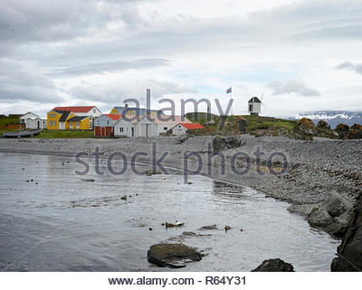 Colourful buildings and the historic windmill at Vigur Island: Westfjords, Iceland. - Stock Image