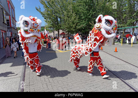 Vancouver, Canada.1st July, 2018. Chinese dragon dancers perform  in the annual Canada Day Parade on Granville Island, Vancouver, British Columbia. This year Canada Day celebrates the country's 151st birthday. Credit: John Mitchell/Alamy Live News - Stock Image
