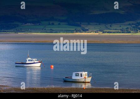 Boats moored on the Menai Strait Beaumaris Anglesey Gwynedd Wales - Stock Image