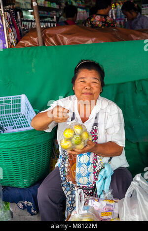 CHIANG MAI, THAILAND - AUGUST 24: Woman sells fruits at the market on August 24, 2016 in Chiang Mai, Thailand. - Stock Image