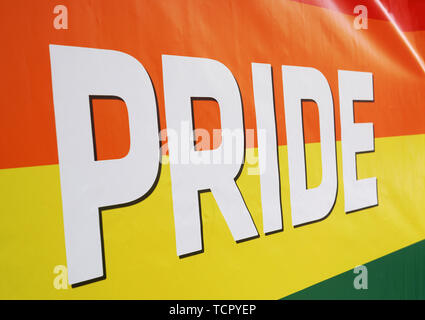 close-up rainbow flag at gay pride event. - Stock Image