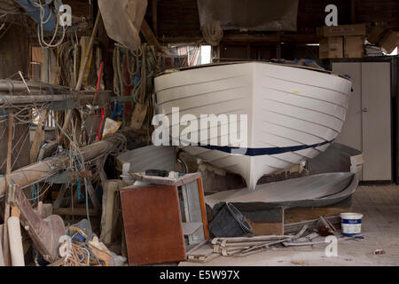 Boat being built/repaired in boat shed. - Stock Image