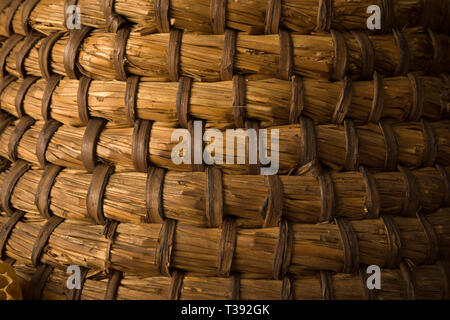 Closeup of the wicker material of a vintage beehive - Stock Image