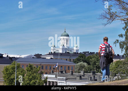 Tourist looking at Helsinki Cathedral from afar - Stock Image