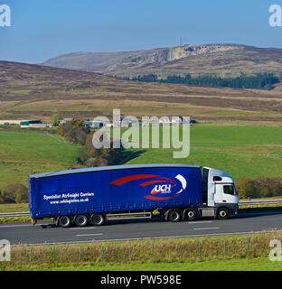 UCH Logistics HGV. Specialist Airfreight Carriers. M6 Northbound carriageway, Shap, Cumbria, England, United Kingdom, Europe. - Stock Image