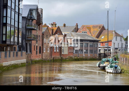 Historic waterfront in Lewes, with the tidal Ouse river flowing by. - Stock Image