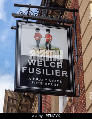 Exterior mounted pub sign outside the Welch Fusilier Craft Union Free House in Wrexham Wales June 2018 - Stock Image