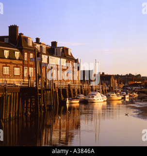 Sunset and sailing boats at Blakeney North Norfolk UK - Stock Image