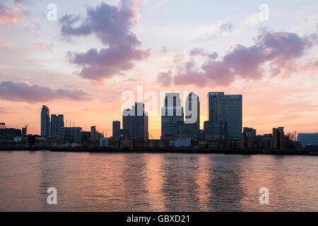 London skyline business district at sunset, Canary Wharf, England - Stock Image