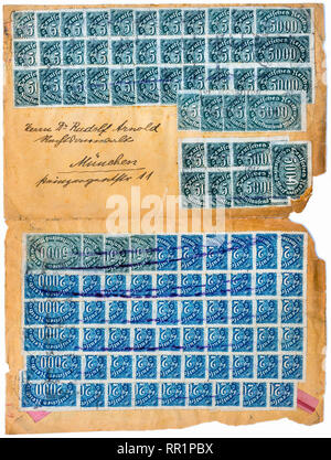 Multiple stamps necessary for tens of millions of marks for letters during German hyper-inflation period in 1923. - Stock Image
