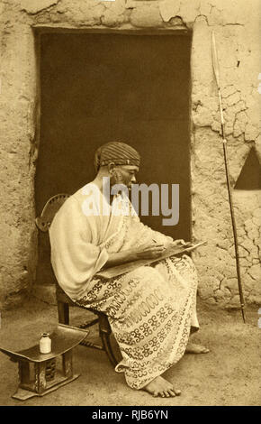 Muslim schoolmaster of Bimbuku, Gold Coast (then part of the British Empire), West Africa, wearing what is claimed to be Manchester cotton. - Stock Image