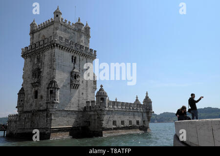 Belém Tower 16thC Portuguese fortress on the River Tagus  and tourist taking selfie photograph photo in Belem Lisbon Portugal Europe EU  KATHY DEWITT - Stock Image