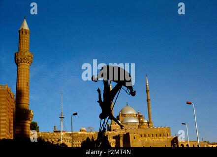 Egypt, Cairo, Citadel District, 1991, the silhouette of a child on a swing stands out against the Muhammad Ali Mosque (19th century, built on the model of Saint Sophia in Istanbul, according to a Turkish architectural tradition) - Stock Image