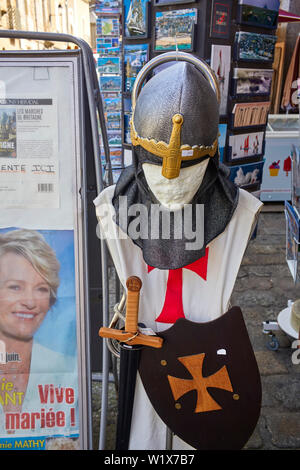 Knight costume for sale outside the castle at Fougères, Brittany, France - Stock Image