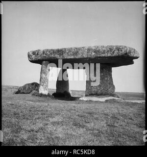 Lanyon Quoit, Madron, Cornwall, 1967-1970. Lanyon Quoit, a Neolithic dolmen, viewed from the west. Lanyon Quoit is a megalithic tomb now in the guardianship of the National Trust. In 1815 the dolmen collapsed during a storm. It was reconstructed with only three of the four stones that had previously supported the capstone. The fourth was considered too badly damaged to be reused. - Stock Image