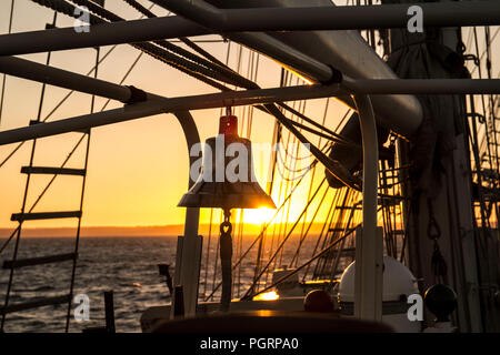 Sunset on the helm of the Lord Nelson tall ship - Stock Image