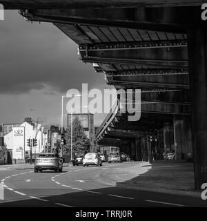 London, England, UK - May 4, 2019: Traffic flows on the Great West Road under the M4 motorway Chiswick Flyover in Brentford, West London. - Stock Image