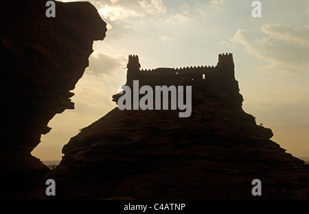 Saudi Arabia, Jouf, Sakaka. Brilliant sunshine silhouettes the brooding outline of the 19th-century Zaabel Fort, - Stock Image