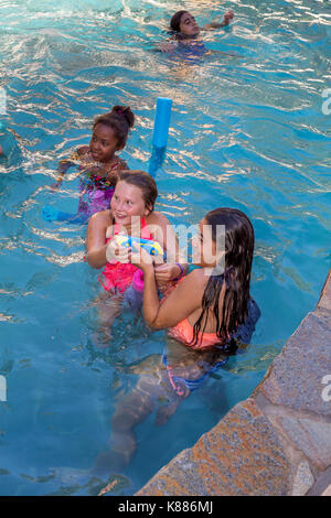 girls, children, playing, squirting water soaker, swimming pool, freshwater swimming pool, pool party, Castro Valley, Alameda County, California, Unit - Stock Image
