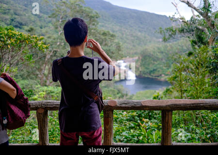 Rear View Of Man Photographing Mountains - Stock Image