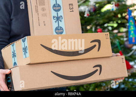 PARIS, FRANCE - DECEMBER 16, 2018: An Amazon Prime package delivered to a residential home for christmas - Stock Image