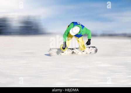 fastest skier under blue sky in mountain - Stock Image