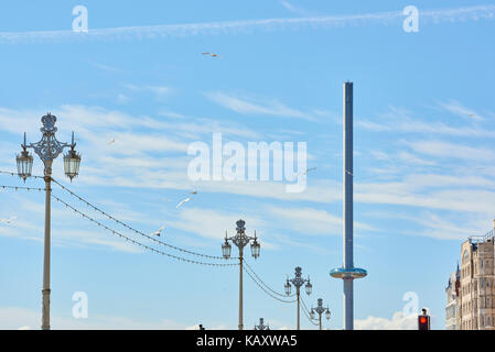Traditional street lamp design in Brighton's seaside promenade, with British Airways i360 viewing tower in the - Stock Image