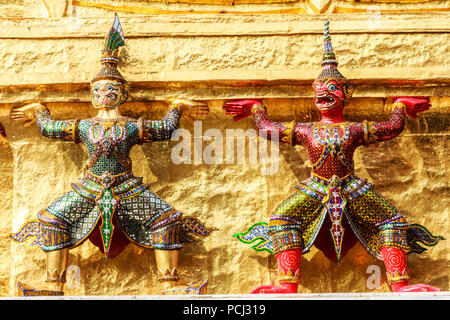 Guardian statues in the Grand Palace, Bangkok, Thailand - Stock Image