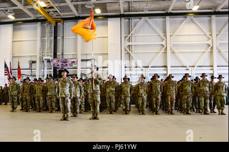 Soldiers from Alpha and Bravo Troops, 1st Squadron, 299th Cavalry Regiment, Hawaii Army National Guard stand at attention during their deployment ceremony at the Kalaeloa Army Aviation Support Facility on August 26, 2018. The 1-299th CAV will be deploying to Sinai, Egypt supporting the Multinational Force and Observers while the 29th IBCT will be deploying to Kosovo in support of Multinational Battle Group EastKosovo Forces (KFOR). (U.S. Army National Guard photo by Sgt. 1st Class Theresa Gualdarama) - Stock Image