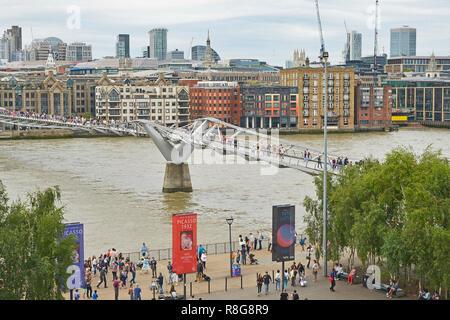 THE MILLENNIUM BRIDGE, THAMES EMBANKMENT, LONDON. AUGUST 2018. The Millennium Footbridge asuspension bridge over the River Thames with the skyline of  - Stock Image