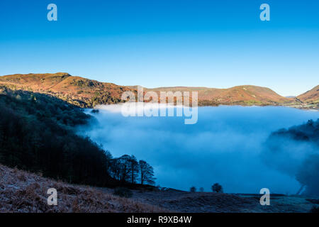 Grasmere under a sea of mist, with Silver How and Helm Crag,  Grasmere, Lake District, Cumbria - Stock Image
