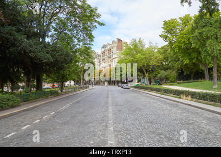 PARIS, FRANCE - JULY 23, 2017: Empty street in Paris with garden and ancient buildings in France - Stock Image