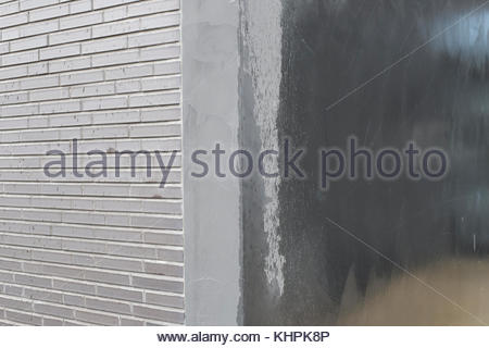Grey silver textured concrete background brick wall - Stock Image