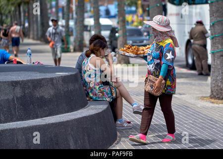 Thailand street food vendor hawking her wares - Stock Image