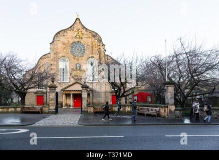 EDINBURGH, SCOTLAND - FEBRUARY 9, 2019 - The Royal Mile, Canongate Kirk and the statue of poet Robert Fergusson - Stock Image
