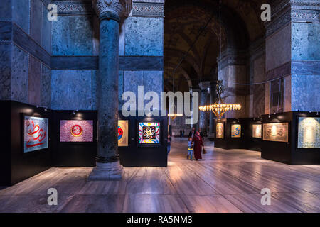 Walls of artwork on display in the Hagia Sophia museum using calligraphy and Arabic lettering, Istanbul, Turkey - Stock Image