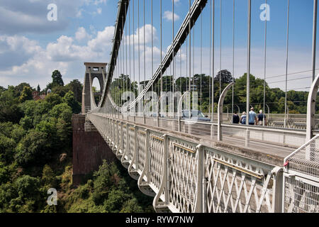 Pedestrians and cars on the Clifton Suspension Bridge spanning Avon Gorge and River Avon, Bristol, UK - Stock Image