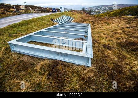 Preparing to install a new cattle grid at Gairloch in the Highlands of Scotland - Stock Image