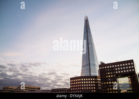 View of the Shard building and, at the bottom right, No. 1 London Bridge as seen from the middle of London Bridge. - Stock Image