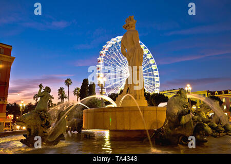 City of Nice Place Massena square and Fountain du Soleil evening view, tourist destination of Franch riviera, Alpes Maritimes department of France - Stock Image