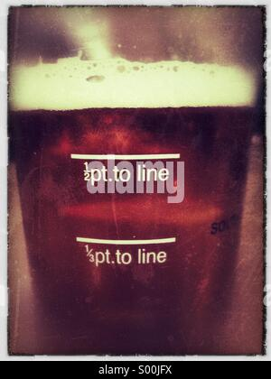 Pint glass of English ale close up. - Stock Image