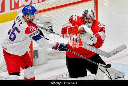 Bratislava, Slovakia. 21st May, 2019. L-R Michal Repik (CZE) and Reto Berra (SUI) in action during the match between Czech Republic and Switzerland within the 2019 IIHF World Championship in Bratislava, Slovakia, on May 21, 2019. Credit: Vit Simanek/CTK Photo/Alamy Live News - Stock Image