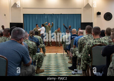 180827-N-GG858-1063 OKINAWA, Japan (Aug. 27, 2018) Sailors assigned to Fleet Activities Okinawa attend an interactive Sexual Assault Prevention and Response (SAPR) training with the Pure Praxis theater group. Pure Praxis, a social theater group contracted by the Department of the Navy SAPR Office in 2015, uses Performance Education Workshops to train and empower service members at military installations worldwide. (U.S. Navy Photo by Mass Communication Specialist 2nd Class Matthew Dickinson) - Stock Image